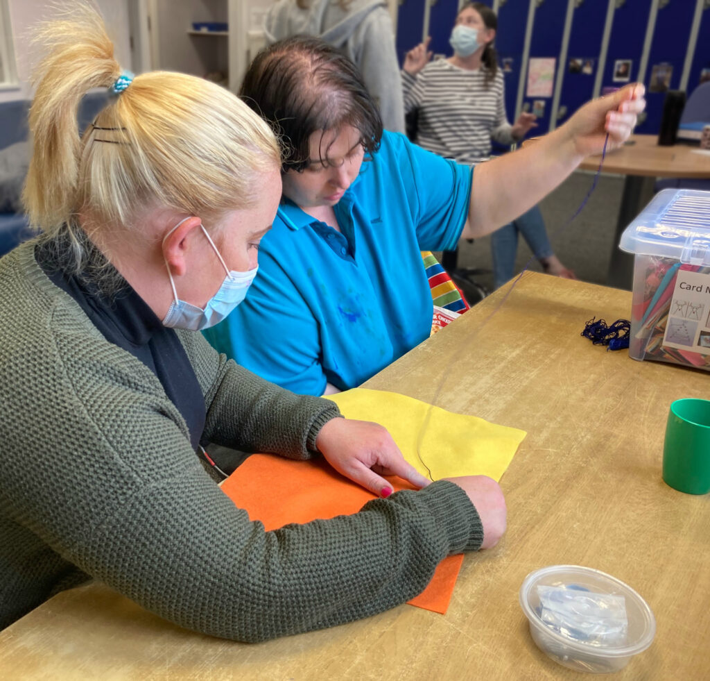 Sewing activity at Leeds Autism Service